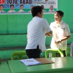 Capt. Abad shakes hands with Kgd. Santos.