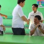 Capt. Abad shakes the hand of Kgd. Custodio.