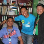 Sec. Misolas, Photographer Pascual and Traffic Enforcer Barrion pose at the Barangay Secretary's cubicle.