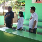 The Barangay Council pays respect to the Philippine flag.