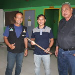 Purok Leader Gerbabuena turns over a 'sumpak' to Peace and Order Committee chairmen. (2)