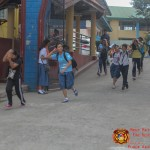 Barangay employees assist BHNHS students during earthquake drill. (15)