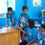Admin. Asst. Monahan facilitates hand-over of new uniforms for street sweepers. (1)