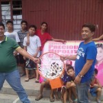 Kgd. Mangune hands over a backboard to IBP Road residents. (1)