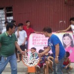 Kgd. Mangune hands over a backboard to IBP Road residents. (2)