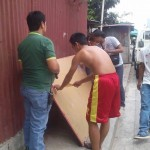 Kgd. Mangune hands over a backboard to IBP Road residents. (4)