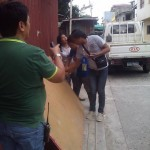 Kgd. Mangune hands over a backboard to IBP Road residents. (5)