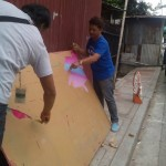 Kgd. Mangune hands over a backboard to IBP Road residents. (6)
