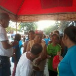 Kgd. Miras gives away groceries and cash to Consti residents. (5)
