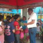 Kgd. Miras gives away groceries and cash to Consti residents. (8)