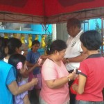 Kgd. Miras gives away groceries and cash to Consti residents. (9)
